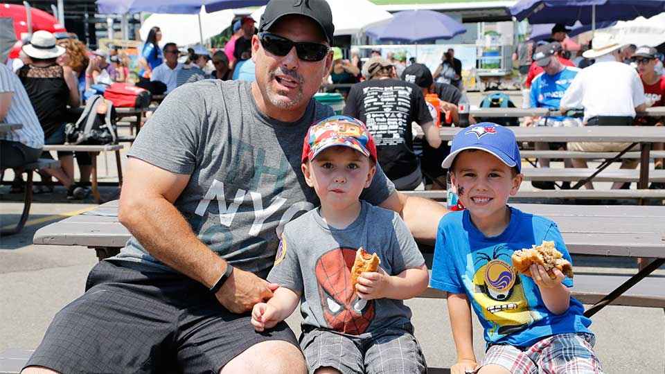 A father and his kids enjoying the Honda Indy Toronto