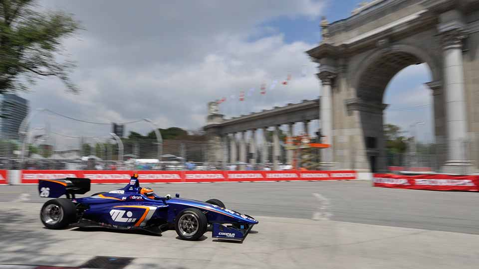 Indy Lights car through turn 1 at the Honda Indy Toronto