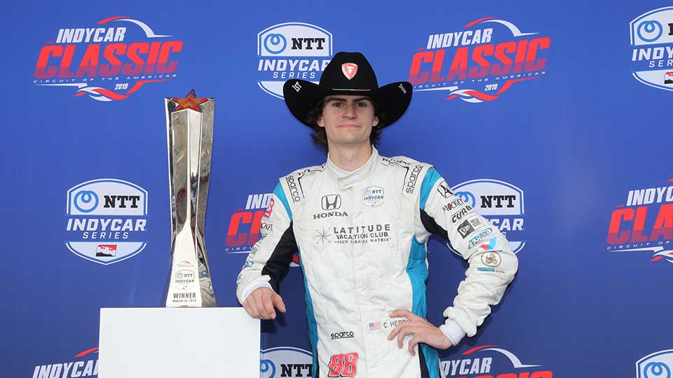 Colton Herta poses with his trophy at the circuit of the americas