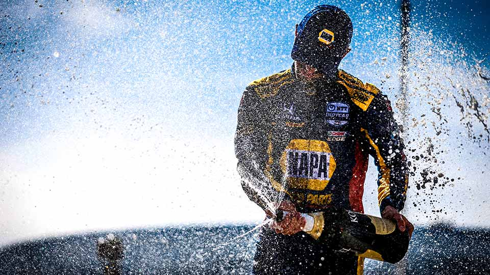 Alexander Rossi Sprays champagne at the Acura Grand Prix of Long Beach