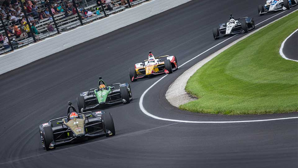 James Hinchcliffe leads a pack of cars at the Indianaopolis Motor Speedway