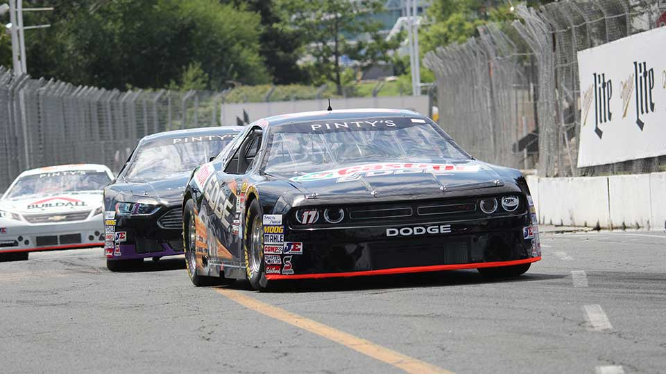 NASCAR Pinty's Series cars race on track