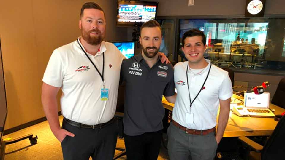 Interns Zach and Santiago with James Hinchcliffe of Schmidt Peterson Motorsports